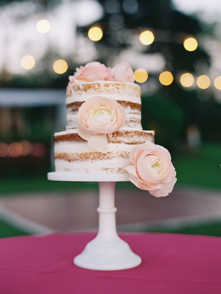 Subtle peach garden roses adorned the two-tier cake from Maui Sweet Cakes bakery.