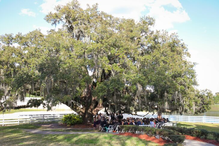 Since spirituality was the focus of their ceremony, Emily and Matt added limited decor to their natural spot, under one of the more than 100-year-old oak trees at Highland Manor in Apopka, Florida.