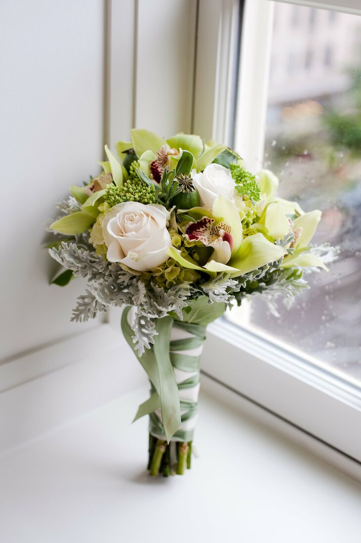 The maids of honor carried roses, orchids and dusty miller in their bouquets.