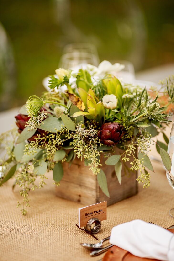Dave and Chad kept flower arrangements to the minimum to let the natural beauty of the farmhouse speak for itself. The centerpieces, however, incorporated square wooden boxes filled with a variety of brunia, anemones, and even artichokes!