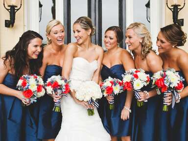 Navy Bridesmaids Holding Red and Blue Bouquets