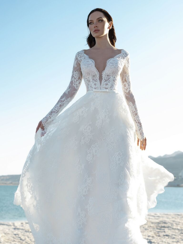 Pnina Tornai Spring 2020 Bridal Collection lace long sleeve A-line wedding dress with illusion lace sleeves and plunging neckline
