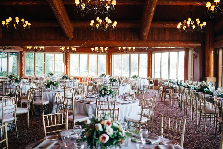 The inside of Shore Lodge in McCall, Idaho, served as the reception space. The peach, pink and ivory centerpieces were made with garden roses, eucalyptus and smilax.