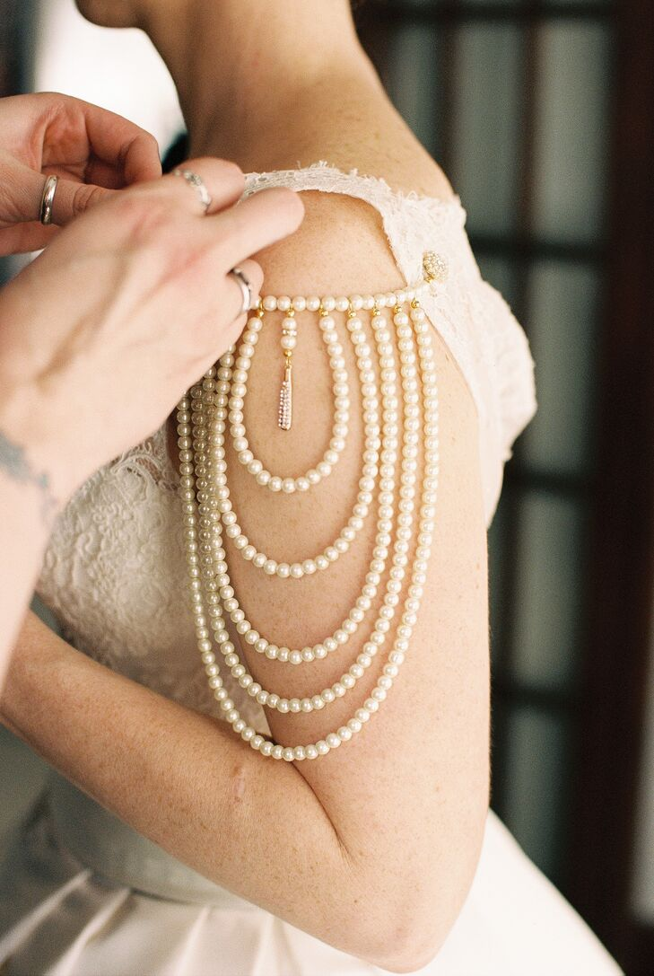 Patricia's cousin made a pair of gorgeous vintage-style pearl epaulets to cover her shoulders. Each bead was well-suited against the lace accents on her ball gown and added just the right vintage flair to Patricia's wedding-day look.