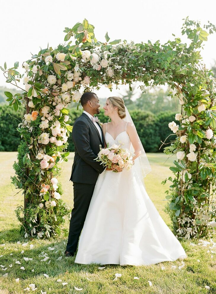 Bride and Groom Wedding Portraits with Floral Arch