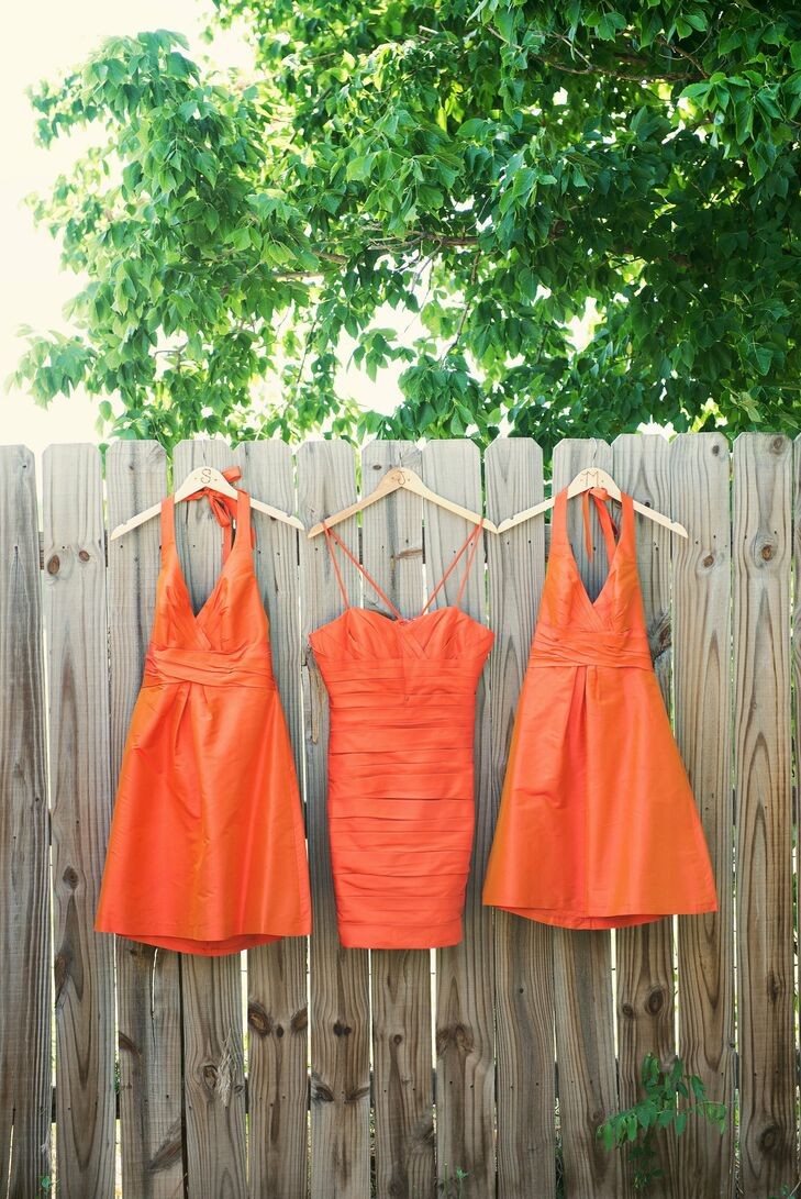 Nicole's bridesmaids were her sisters and she told them that they  could wear whatever they wanted and to her surprise, they all picked out the same orange silk dress but in different styles.