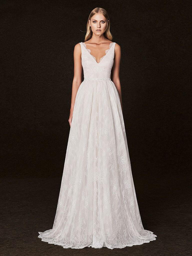 Victoria Kyriakides Fall 2017 v-neck bodice with chantilly lace edging and an aline lace skirt with scalloped hem