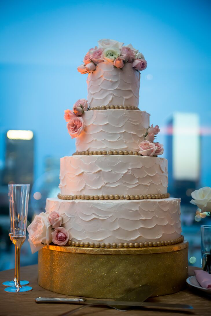 Kate and Will went with a pretty, classic white wedding cake. It had four textured white tiers and fresh pink flowers for an added touch of romance.