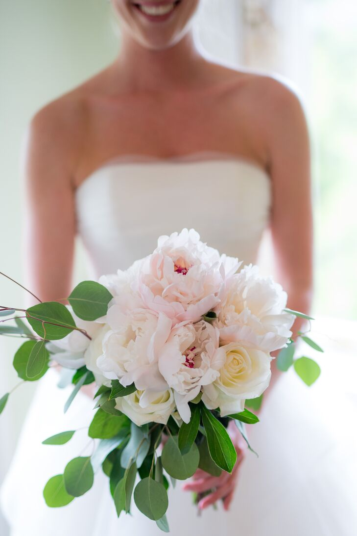Elizabeth carried locally grown white peonies, silver dollar eucalyptus and white roses in her lush bouquet. Elizabeth, Tim and their family and friends arranged all of the florals for the day. Elizabeth loved how the florals complemented her Southern spring garden theme.