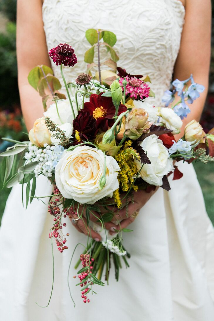 Kassie's bouquet was loose and textural, featuring the perfect autumn palette of cream, burgundy, green, gold and pops of pastels for added interest.