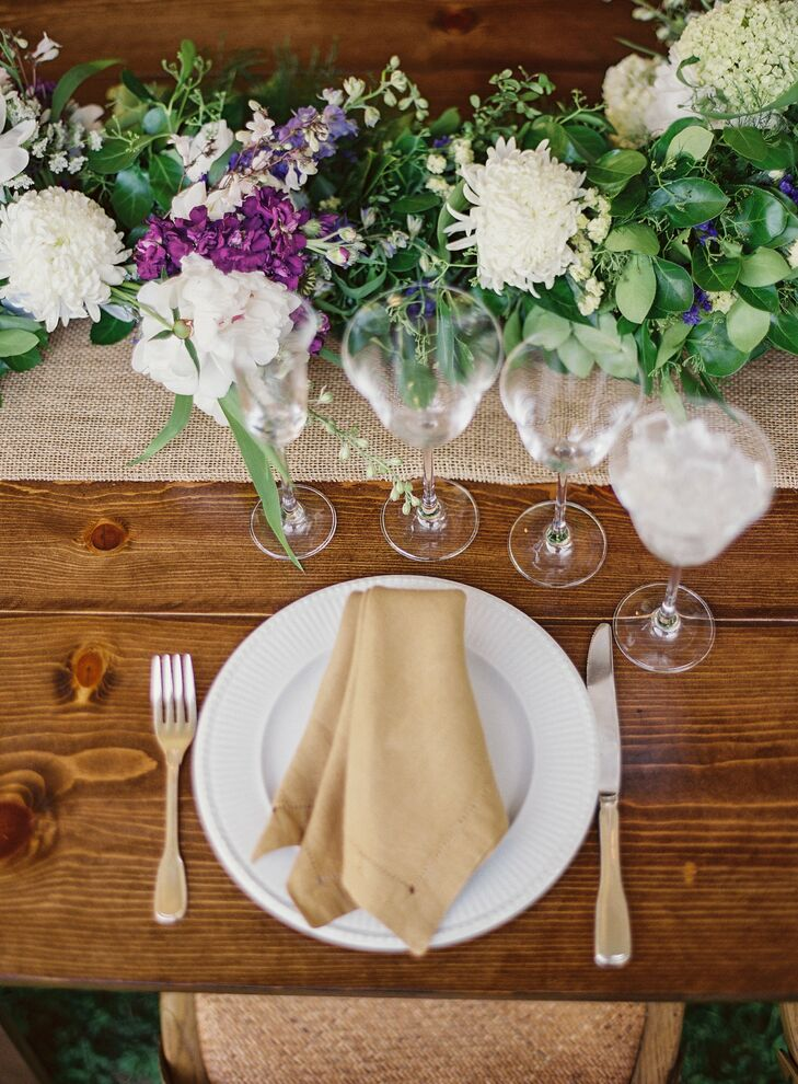 Ayse and Jack carried their neutral color palette to the reception by dressing up their long farm tables with burlap table runners, simple white plates and brown linen napkins.