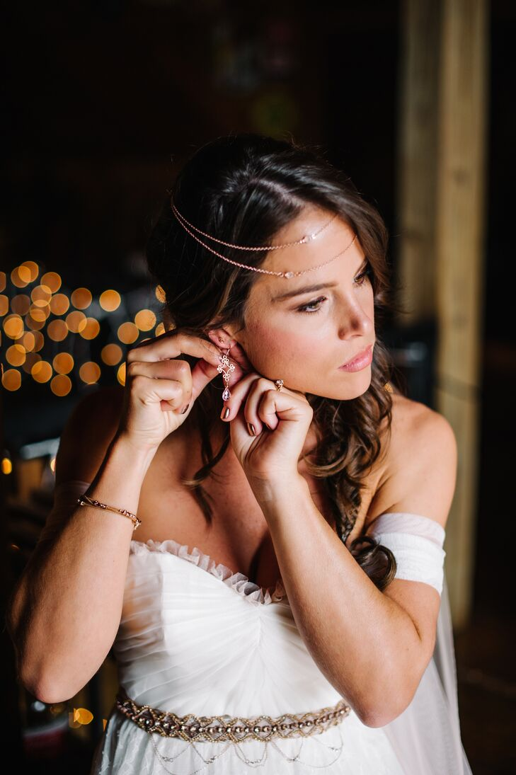 """All of Shelby's jewelry matched her rose gold engagement ring. She wore a chic Fossil bracelet, two pairs of rose gold earrings from Etsy and a bohemian DIY headband. """"Sometimes when you can't find what you're looking for, you just gotta make it happen some way or another,"""" she says. """"I draped the same necklace chains in my hair that I used in my [DIY rose gold] belt."""""""