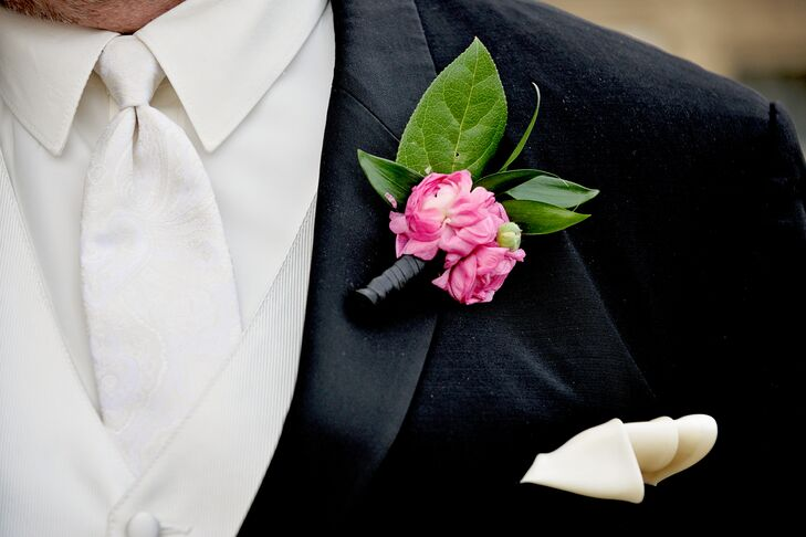 While Matthew's wedding day look had a classic vibe, he incorporated a subtle nod to the day's bright and bold theme with the addition of a pink ranunculus boutonniere. And to tie the look together, he added a polished ivory pocket square.