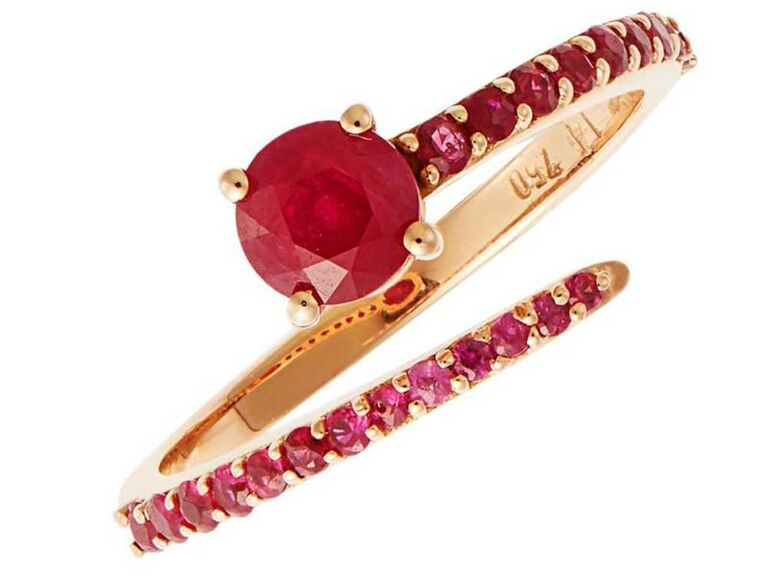 Open ruby engagement ring with pavé ruby stone band