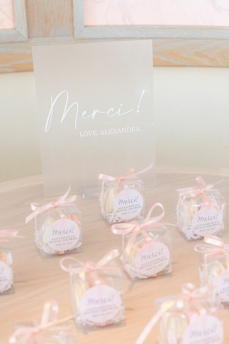 Macaron shower favors in clear plastic boxes