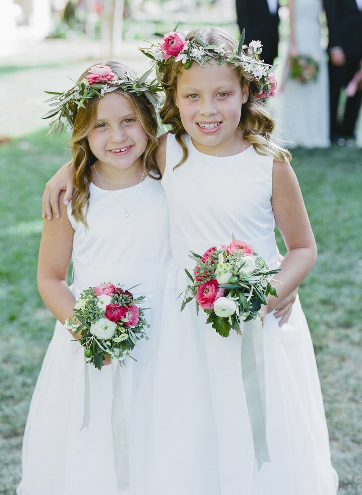The flower girls brightened up their look with pink ranunculus flower crowns and bouquets.