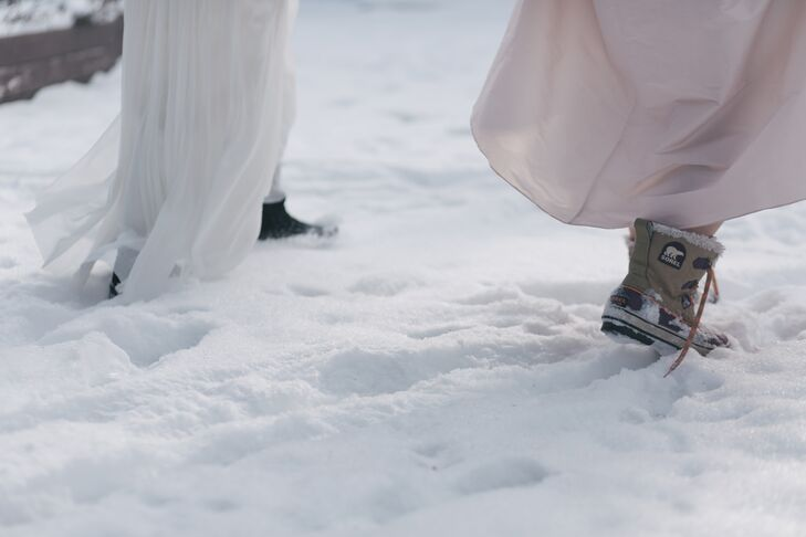 Practical footwear is a must during a Minnesota winter wedding. Jillian and Sally opted for Sorels.