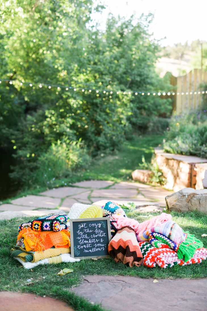 "A handwritten chalkboard sign invited guests to stay ""cozy"" and grab a blanket if the temperature dipped after sundown."
