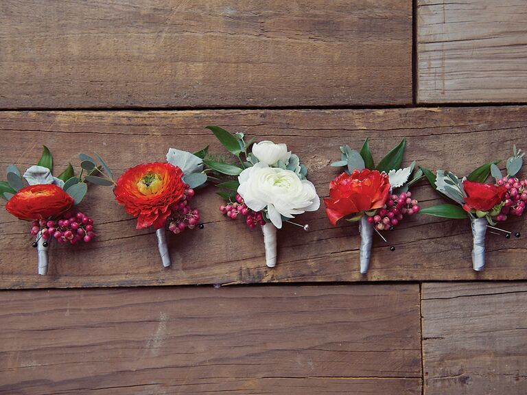 Red and white runanculus boutonniere