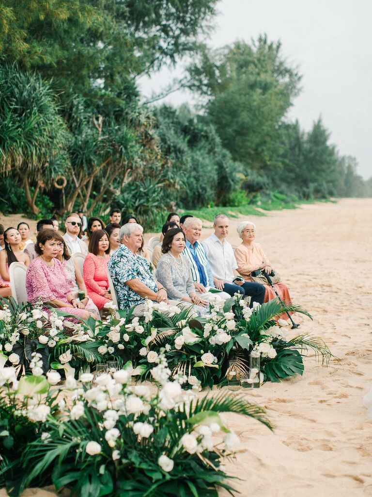 Guests at beach wedding in Thailand