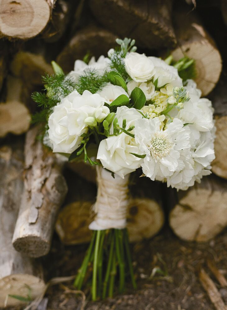 A wild gathering of cream-colored freesias, roses, scabiosas and stock made up Karine's bouquet.