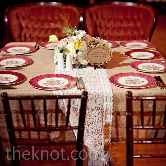 Mixing burlap, lace and vintage china with different chairs created a warm and welcoming reception style.