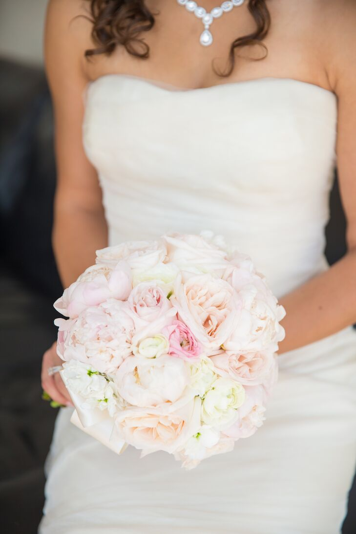 Emily carried a compact bouquet filled with her favorite flowers, including blush peonies and a fresh mix of roses. For a personal touch, the bride and her maid of honor wrapped their bouquets in matching pieces of white and gold fabric covered in rhinestones.
