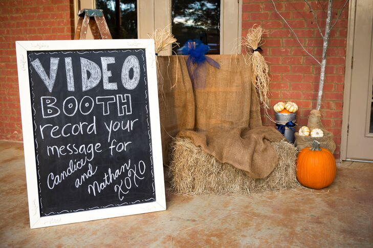 Candice and Nathan knew their guests would want to snag a few pictures with the down-home decor, so they set up a rustic fall backdrop for video messages and pictures.