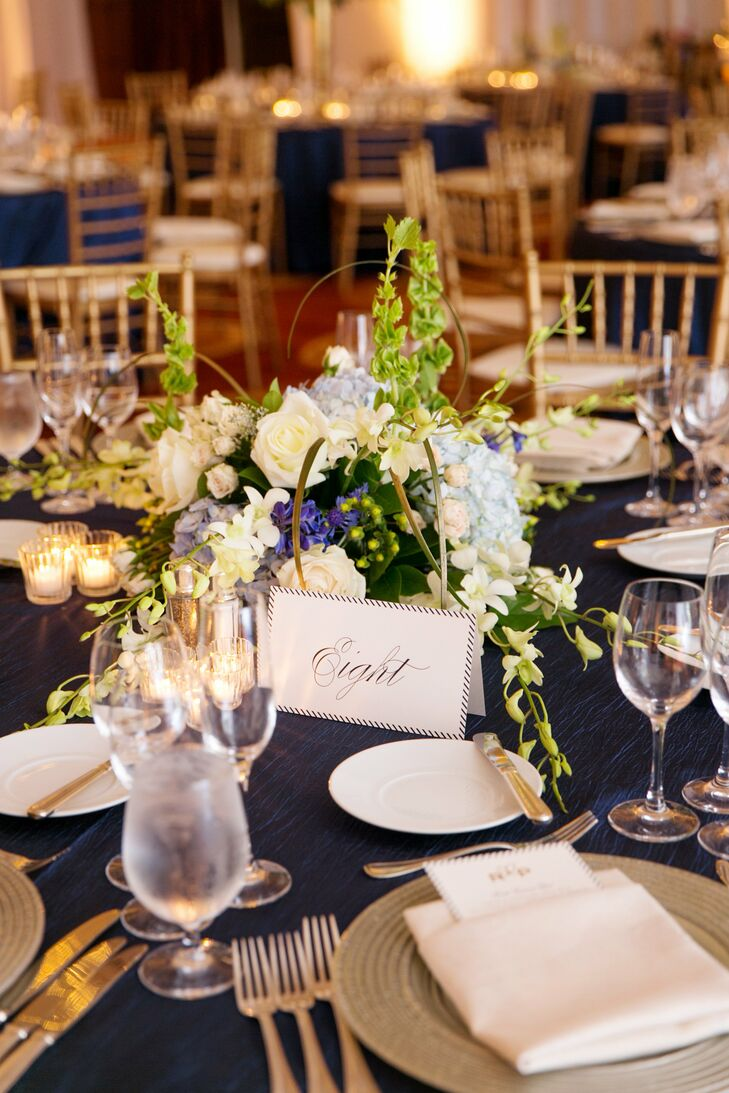 The table numbers were written in an elegant script typeface and had a navy striped border to match the menu cards.