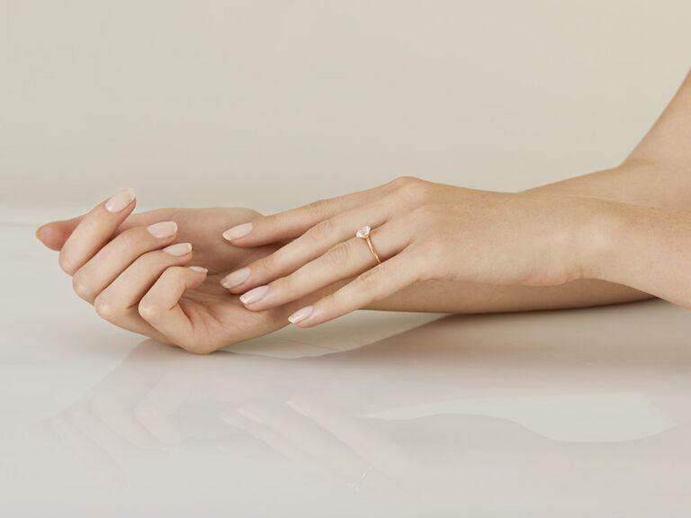 Fluorescent diamond alternative engagement ring