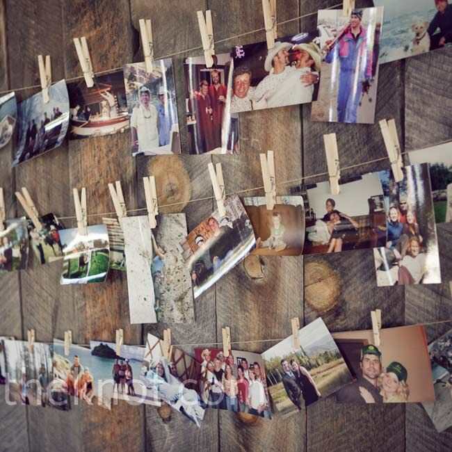 The couple hung photos of themselves with friends and family from pieces of clothesline and pins for a rustic touch.