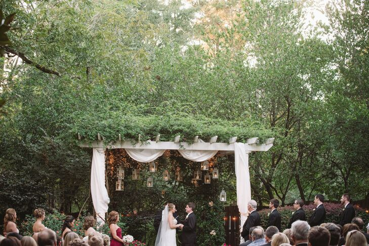 "The couple exchanged vows during a sunset garden ceremony with a shabby-chic vibe. ""I knew that I wanted to stay true to the style of the venue and to our South Carolina routes,"" says Stacy. ""We wanted to keep it classic, formal and romantic with lots of candles."""
