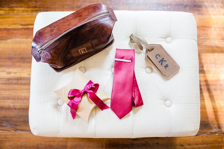 Allison and Zane gave the groomsmen matching monogrammed tie clips from Etsy.com for a little old-school flair. In addition to their fall-inspired berry ties, brown shoes, a brown belt and charcoal gray socks were the menswear accessories.