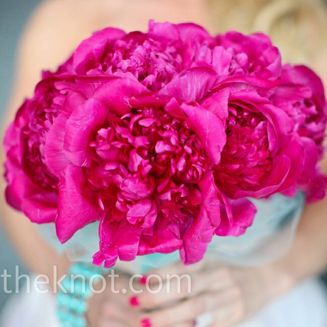 Brittney carried a chic monochromatic bunch of open fuchsia peonies wrapped with aqua tulle.