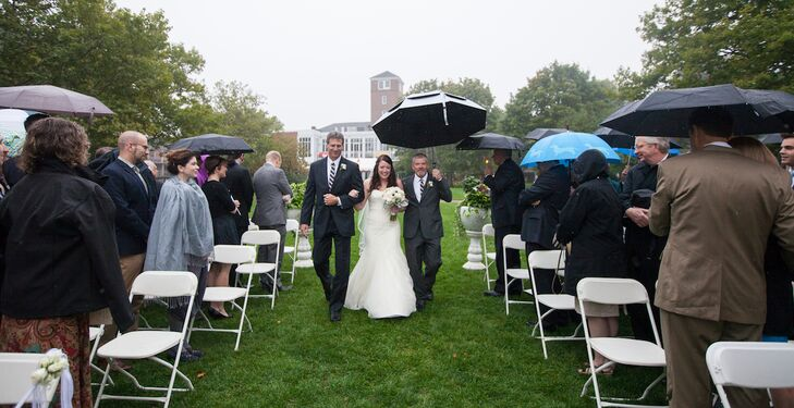 """""""Although it rained on the day, the site was still lovely and guests could enjoy watching the boats on the Merrimack River through the fog and mist,"""" the couple says."""