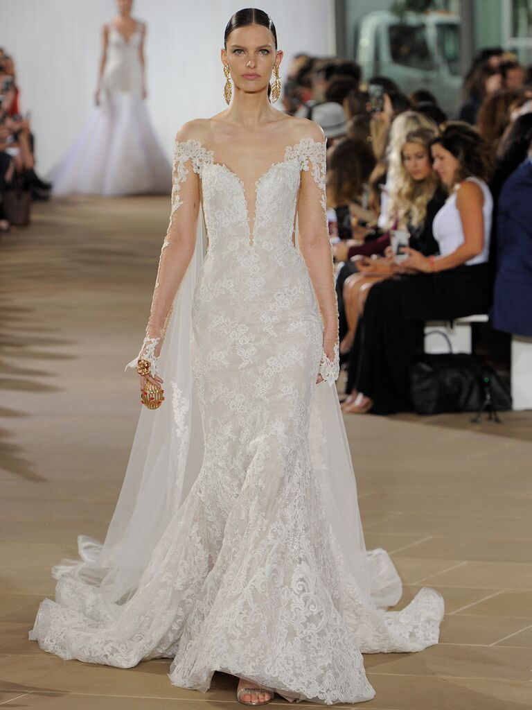 Ines Di Santo Fall 2019 lace wedding dress with a trumpet skirt, plunging neckline and cape