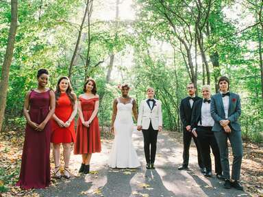 Same sex couple with their wedding party
