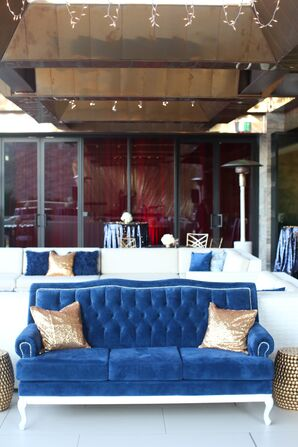 Lounge Furniture with Blue Couches and Gold Pillows