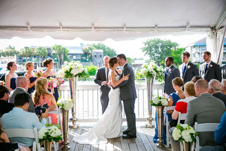 The ceremony space at Cottage on the Creek in Charleston, South Carolina, was kept simple and chic, with white chairs, a white tent and silver urns spilling with white hydrangeas, garden roses, ferns and other greenery.