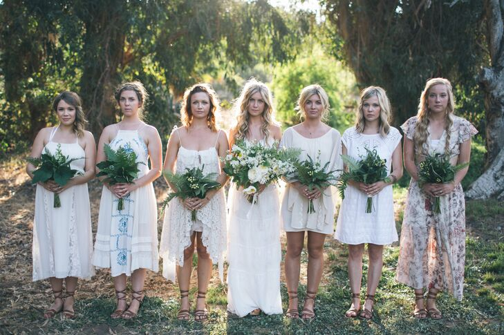 Rebekah's six bridesmaids wore their own white or ivory dresses. Greek-style sandals gave them a cohesive look.