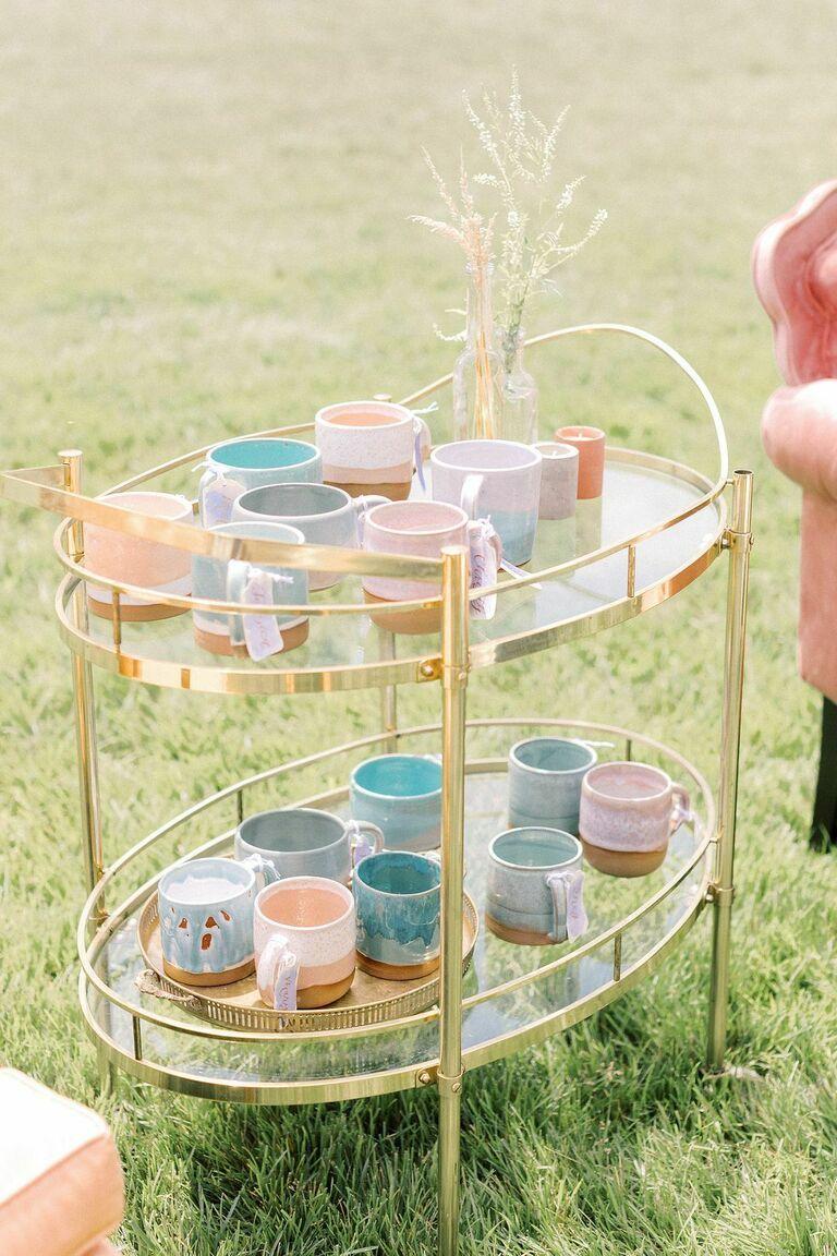 Bar cart with pastel-hued coffee mugs
