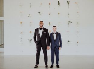"DeAndre	Upshaw (left) and Stuart Hausmann incorporated plenty of fun, colorful details into their modern wedding at Prospect House. ""For many of our g"