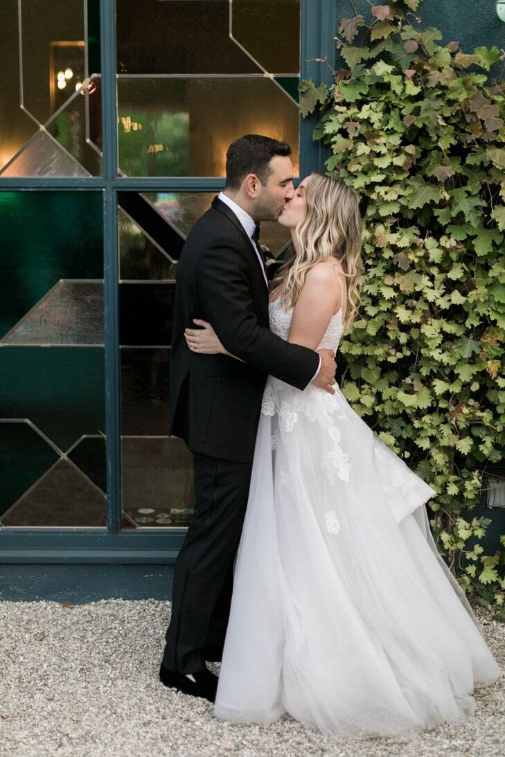 Romantic Couple with Black Suit and A-line Wedding Dress