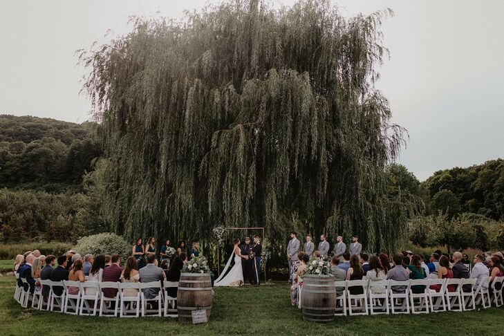 Natural, Bohemian Ceremony Beneath a Willow Tree at Nostrano Vineyards in Milton, New York