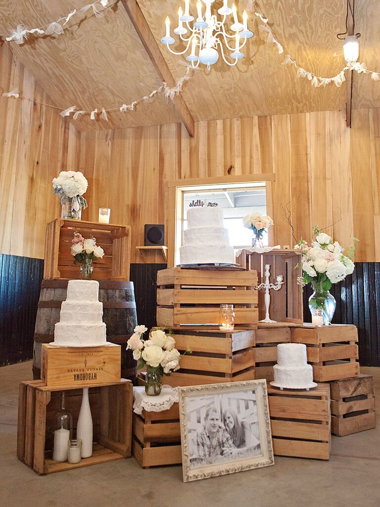 Cake stands and rustic wooden crate decor for a wedding reception