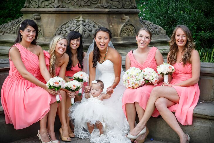 As Jen wanted her bridesmaids to showcase their individual styles, they wore pink knee-length dresses with different necklines.
