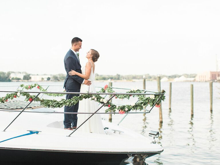 Couple leaving their wedding on a boat