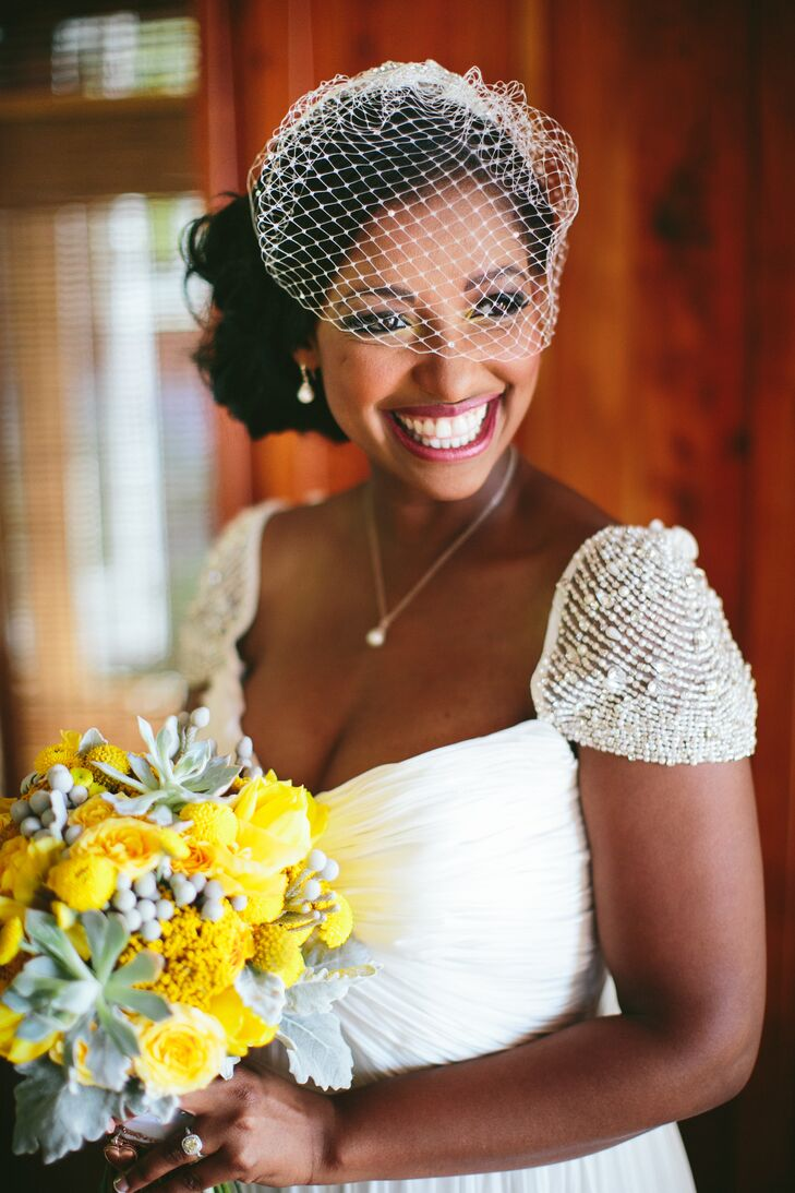 Charita decided on a flowy vintage-inspired dress that was airy enough for her beach locale yet still felt formal. She completed her Gatsby-esque look with a birdcage veil and an embellished headband that matched her beaded cap sleeves.