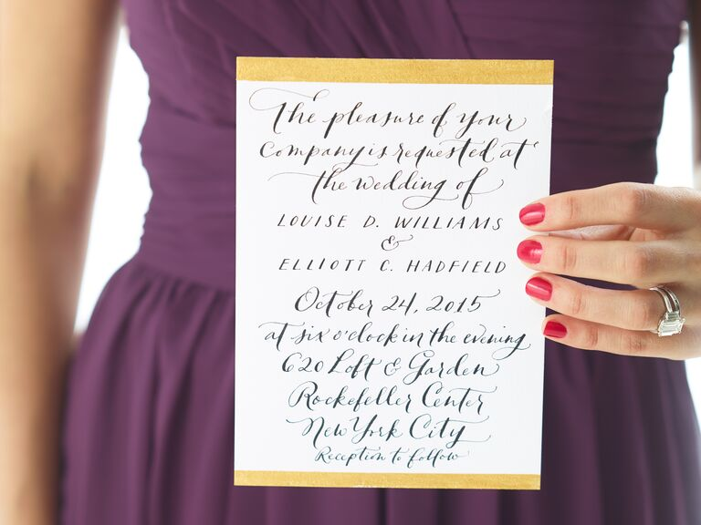 White and gold calligraphed invitations