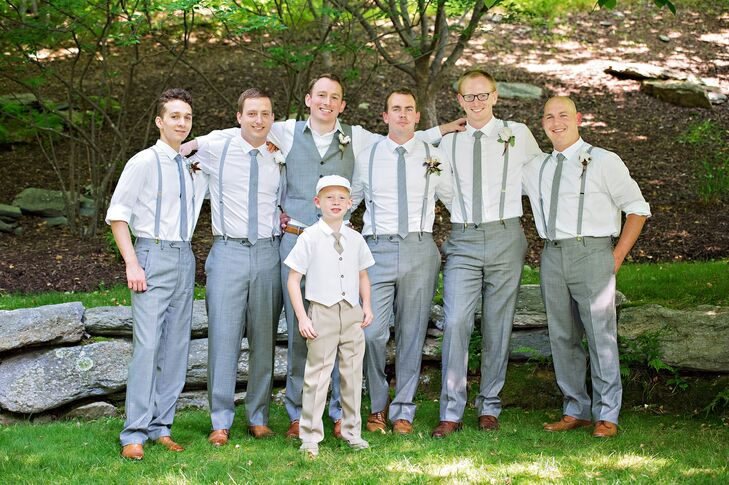 Rob's groomsmen wore gray suspenders and gray ties with their gray trousers. Rob sported a gray vest.